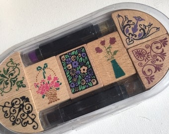 A Set of Floral Border Rubber Stamps with Ink Pads
