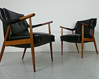 pair mid century Danish modern black leatherette Peter Hvidt style lounge chairs