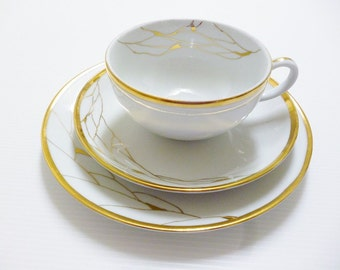 "Teacup and dessert plate ""white and gold"""