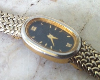 Vintage womens Watch, Seiko Watch, Quartz, gold plate, oval shape black dial, base metal, stainless steel, 2e29-6359 RO / 852449