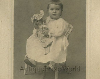 Cute baby with toy porcelain doll antique photo