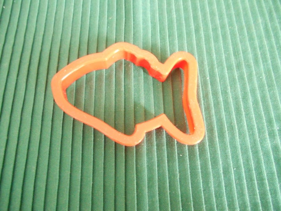 A red fish shaped cookie cutter 3 1 2 inches long by 2 3 8 for Fish shaped cookie cutters