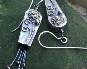 Hollow formed, fine silver floral wind chime earrings