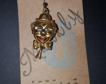 1960's gold tone Monet mechanical clown charm