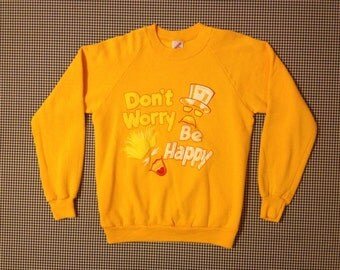 "1980's, ""Don't Worry Be Happy"" sweatshirt, in bright yellow, Adult size Medium"