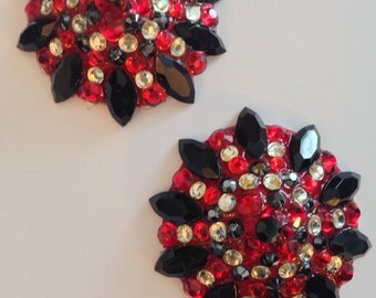Red, black and gold pasties