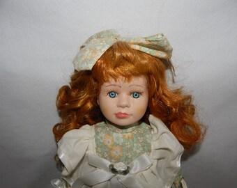 Vintage Porcelain Doll with Light Green Flowered Dress