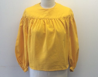 Fabulous 1960's vintage bright sunshine yellow blouse with balloon puffed sleeves