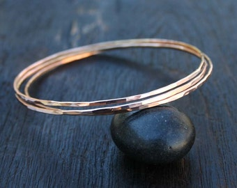 14k solid rose gold bangle bracelet. Rose gold bracelet. 14k solid gold bangle. Hammered. Single, set of three, five or seven. Gold jewelry.