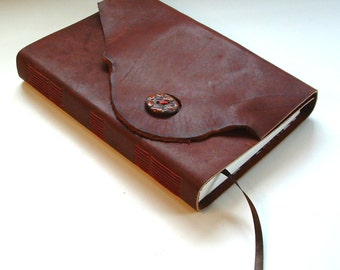 Leather blank book, hand-made, with original ceramic coffee-bean button closure. A coffee-lover's journal, diary, sketchbook.