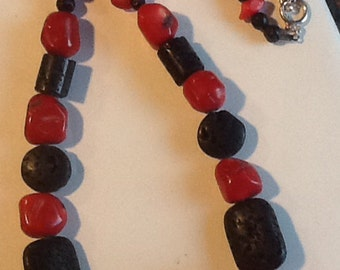 Necklace and earring set. Red coral /black lava rock