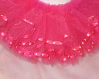 Hot pink tutu trimmed with matching polka dot ribbon