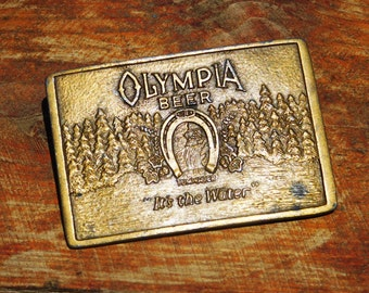 Vintage 70s Olympia Beer It's The Water Brass Belt Buckle