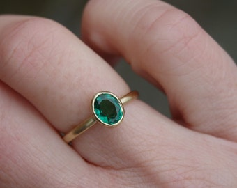 18ct yellow gold emerald ring, oval emerald ring