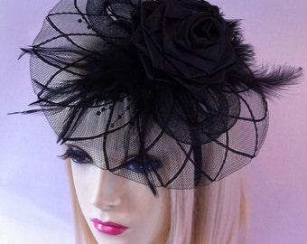 Black saucer fascinator hat on a head band hair piece hat wedding ladies day races fashion designer party dress rose bow topper