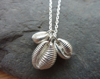 Cowrie shell necklace in sterling silver...