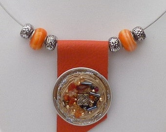 Necklace with leather pendant