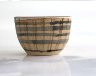 small tea bowl in blue and white ceramics , handmade