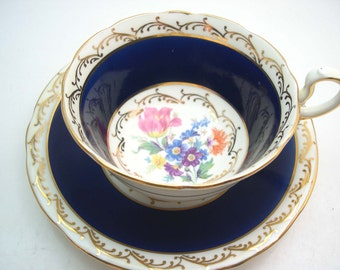 Antique Aynsley Cobalt Blue tea cup and saucer, English tea cup set, Cobalt blue and gold tea cup set with flowers.