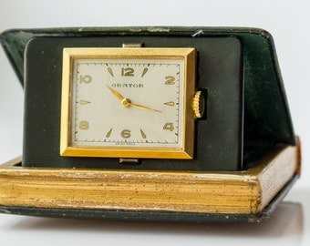 Vintage Swiss Orator Travel Clock in a Tooled Leather Book Case Miniature Book Form Travel Watch