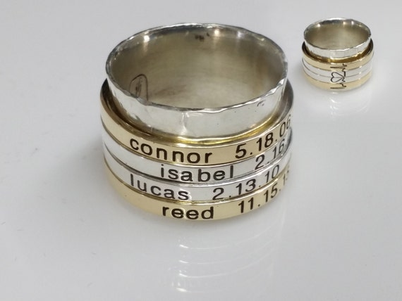 Spinner ring. Sterling silver ring with 4 custom engraved spinners. Completely customized, personalized, and unique.