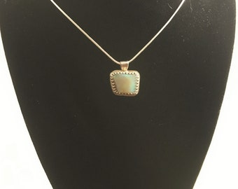 Custom cut Australian opal pendent in a sterling silver setting with a silver plated chain