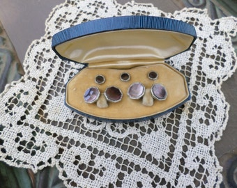 antique cuff buttons in  case