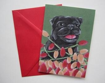 Black Pug Tangled in Christmas Lights Card, Pug Tangled in Lights Greeting Card, Holiday Pug Card by Amber Maki