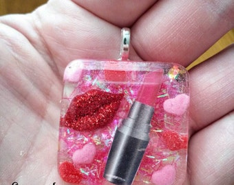 Adorable makeup lipstick charm pendant with heart background