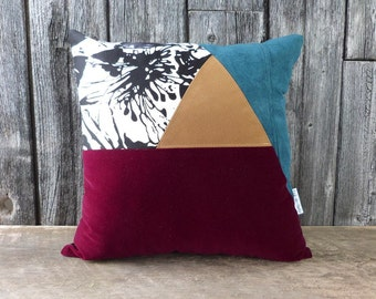 Geometrical pillow cover with a suede triangle