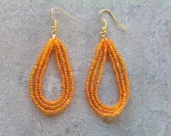 Sparkly orange, hoop earrings....2 1/2 inches long