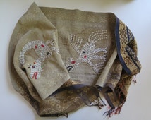 Vintage Handspun handwoven Ikat. Indonesian cloth. Embellished with dragons embroidered with nassa shells