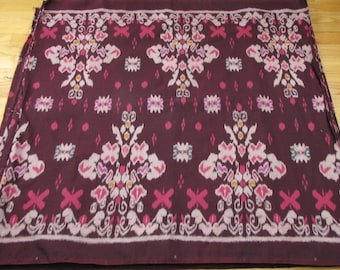 Hand woven maroon, floral cotton Ikat by the yard