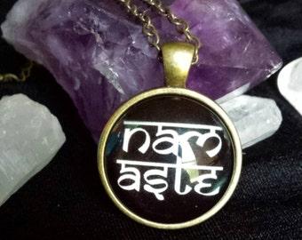 Bronze Colored Namaste Glass Cabochon Necklace
