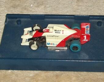AFX #1 Racecar HO Race Car MOBIL Bosch Goodyear, always the fastest car on the tracks!