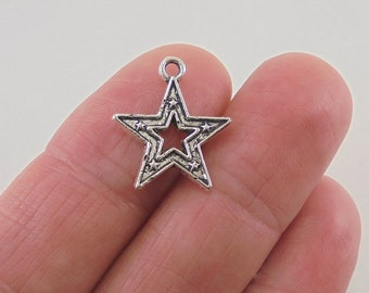 9 pc. Star charm, 18x16, antique silver finish
