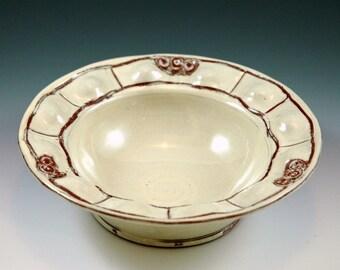 Small bowl vanilla colored.