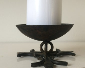 Black cast iron candle holder