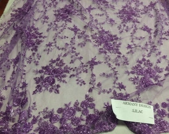 Gorgeous lilac flower design embroider and beaded on a mesh lace. Wedding/Prom/Bridal/Nightgown fabric.