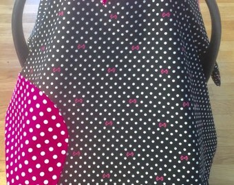 Adorable and feminine pink and black polka dot reversible car seat canopy with ribbon ties