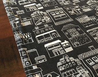 Townhouses fabric table runner.Add a special touch to your dining or outdoor table.Theme it to your decor or accent colour.Made to Order.