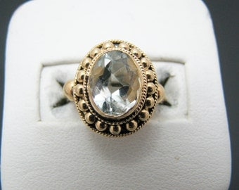 Pretty Vintage 18k Yellow Gold ring with a Large Very Light Blue Bezel Set Stone