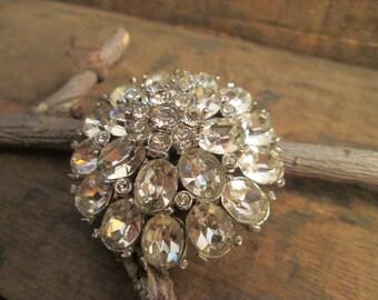 vintage silver tone round cut clear rhinestone floral brooch