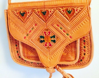 small leather tooled purse