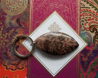 Unique keyring. Leopard-spot agate stone on stainless steel ring. Muted pink, with brown and black markings. Unusual. One of a kind.