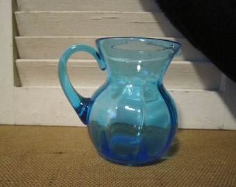Beautiful turquoise blue blown glass pitcher