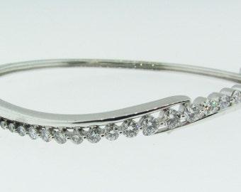 Vintage 14 Karat white gold and diamond bangle tennis bracelet.