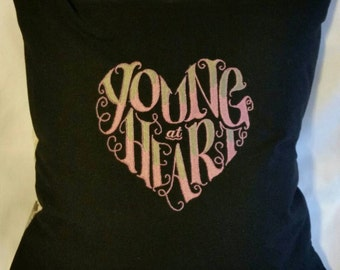 Young at heart   handcrafted embroidered pillow cover