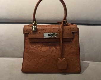 Vintage Rossi & Caruso golden brown ostrich leather handbag with gold hardware