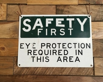 "Vintage industrial 'safety first' factory sign 10"" x 14"""